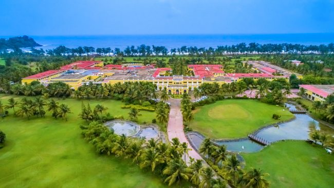 the lalit golf resort aerial clubhouse image